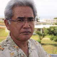 Tainted legacy: Seiryo Arakaki (above), chairman of the Okinawa Prefectural Assembly's special committee on U.S. bases, stands at the former U.S. military land of Nishi-Futenma, while pollution fears leave the housing area's redevelopment in limbo. | JON MITCHELL