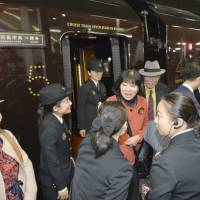 Romance rekindled: A platform in JR Hakata Station is filled with passengers from the Seven Stars luxury train.   KYODO