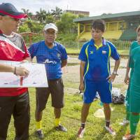 Best foot forward: Yoshinori Kumada (left) gives some pointers to members of the Myanmar women's national soccer team in Yangon in October.   KYODO