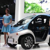 Shape of things to come: An ultracompact T-Com vehicle is showcased by Toyota Auto Body Co. at the Tokyo Motor Show that ended on Dec. 1. | KAZUAKI NAGATA