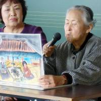Survivor's lesson: Yoshi Tabata uses handmade picture cards to tell a story based on her experience of surviving the 1933 tsunami that hit the Sanriku region in Iwate Prefecture. | KYODO