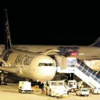 Center of activity: An All Nippon Airways cargo plane prepares for a late-night takeoff at the carrier's freight hub in Naha, Okinawa Prefecture. | WEDGE