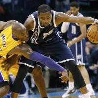 Thunderstruck: The Thunder's Kevin Durant keeps the ball away from Lakers guard Kobe Bryant on Friday. | AP