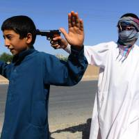 Limited options: Afghan children play with plastic toy guns during the second day of Eid al-Fitr in Herat in August.   AFP-JIJI