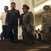 Shaded nation: North Korean leader Kim Jong Un (second from left) tours the newly opened Fatherland Liberation War Museum on July 27. With him are his uncle Jang Song Thaek (right); the vice president of the Presidium of North Korea's parliament, Yang Hyong Sop (second from right); and Vice Marshal Choe Ryong Hae (left). | AP