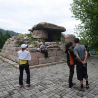 History lives: Tourists visit Koguryo dynasty tombs at a heritage park in the Chinese city of Jian at the end of August. | AFP-JIJI