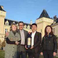 Celebration: Chinese billionaire Lam Kok (second from right) and his wife are seen Friday with the French former owner of the Chateau de la Riviere, James Gregoire, and his wife. | AFP-JIJI