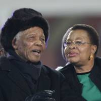 Third time lucky: Former President Nelson Mandela and his third wife, Graca Machel, arrive for the 2010 World Cup match between the Netherlands and Spain on July 11, 2010, in Soweto, suburban Johannesburg. | AFP-JIJI