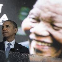 Long time coming: U.S. President Barack Obama speaks at a memorial service for former South African President and anti-apartheid hero Nelson Mandela in Johannesburg on Tuesday.   AFP-JIJI