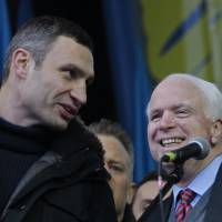 Heavyweights: Boxing champion and chairman of the opposition party Punch, Vitali Klitschko (left), speaks to U.S. Sen. John McCain during a rally in Kiev on Sunday. | AP
