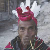 Avowed Baptist: Htang Ling Kaw, an ethnic Chin, leaves a neighbor's house in Kyar Do on Dec 18.   AP