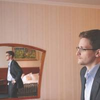 Breaking his silence: Edward Snowden, the former National Security Agency contractor who revealed information about NSA surveillance programs, is interviewed in a hotel room in Moscow this month. | THE WASHINGTON POST