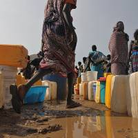 Displaced: South Sudanese who have fled ethnic fighting line up for water Saturday at the U.N. mission in South in Juba. | AFP-JIJI