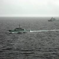 Polar opposites: The Canadian warships HMCS Summerside and HMCS Fredericton patrol the Arctic in August 2007 as part of Operation Nanook, Canada's largest-ever military exercise to assert sovereignty over the Arctic. | AFP-JIJI