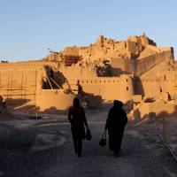 One of a kind: Iranian women visit the citadel of Arg'e Bam on Dec. 18. Experts who are painstakingly rebuilding it say Iran's architectural masterpiece will never be the same. | AFP-JIJI