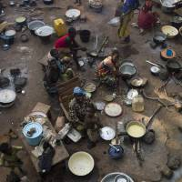 Desperate measures: Christian refugees gather in a camp in Bossangoa, Central African Republic, on Wednesday. | AFP-JIJI
