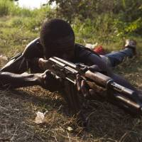Christian 'anti-balaka' militiamen train on the outskirts of Bangui on Tuesday. | AFP-JIJI