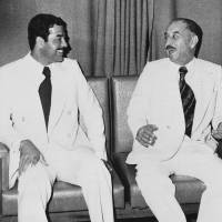 Former allies: Iraqi President Ahmed Hassan al-Bakr (right) and Saddam Hussein sit together in Baghdad in November 1978. | AP