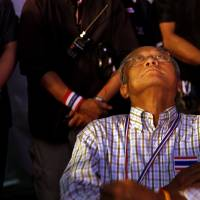 Things looking up?: Anti-government protest leader Suthep Thaugsub looks up as he waits to speak during a rally outside Government House, which houses the offices of Thai Prime Minister Yingluck Shinawatra, in Bangkok on Tuesday. | AP