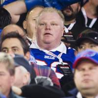 No time-outs left: Toronto Mayor Rob Ford watches an NFL game between the Buffalo Bills and the Atlanta Falcons in Toronto last Sunday. | AP