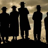 Shoring up connections: Ultra-Orthodox Jewish men gather near Haifa, Israel, on Dec. 9. Jewish leaders in the country met last month in an effort to reach out to Jewish-Americans, who are becoming increasingly estranged from Judaism. | AFP-JIJI