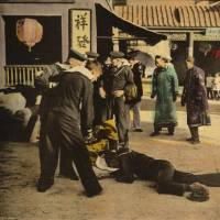 Casualties: This undated handout image provided by the Library of Congress shows a motion picture lobby card for D.W. Griffith's 'Broken Blossoms' (1919), showing sailors standing over two bodies on a dirt street in Chinatown. | AP