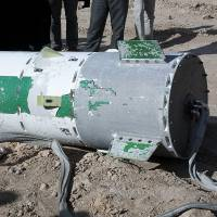 Barrel full of monkey: In this photo released on Saturday by the Iranian Students News Agency, a capsule lies on the ground containing a monkey during a mission to send it into space.   AP