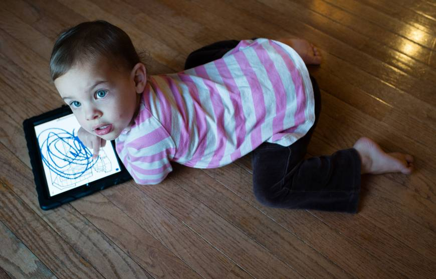 Infant tablet devices hit by parents, experts