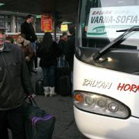 Apres moi, le deluge?: A man boards a bus departing the Black Sea town of  Varna and heading for London via the Bulgarian capital, Sofia. Britain is bracing for an influx of Bulgarians and Romanians after immigration restrictions are relaxed on Jan. 1. | AP