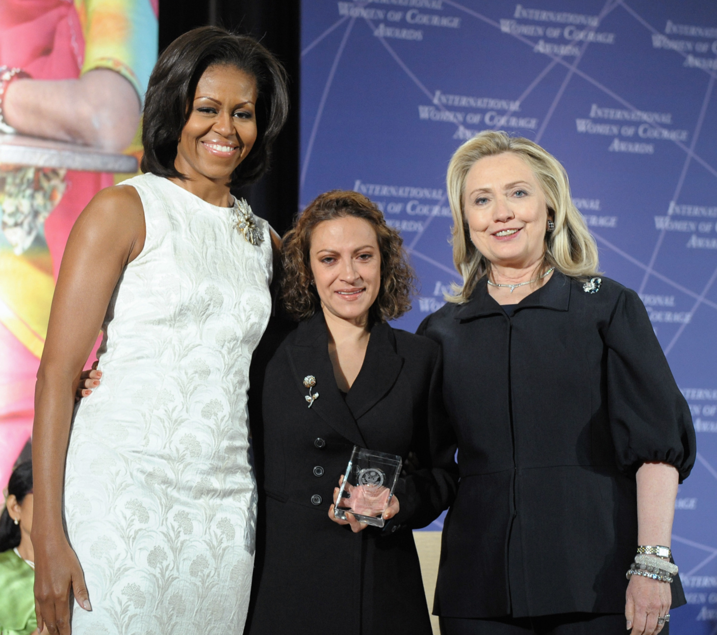 Speaking the unspeakable: Colombia's Jineth Bedoya Lima (center), the 2012 winner of the International Women of Courage Award, poses for a photo in March 2012 with then-U.S. Secretary of State Hillary Rodham Clinton (right) and first lady Michelle Obama. | WIKIPEDIA