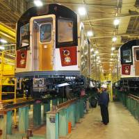 Getting a roll-by: A worker checks subway cars at a Kawasaki Heavy Industries Ltd. plant in New York on Nov. 15. | KYODO