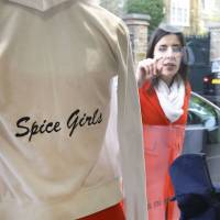 Spice at a fraction of the price: A woman looks through the window at items donated by the Beckhams at a Red Cross charity shop in London last month. | AP
