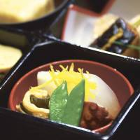 Traditional 'washoku' Japanese cuisine, like the fare served at the  restaurant Kikunoi in Tokyo (right), was designated an Intangible Cultural Heritage on Dec. 4. | BLOOMBERG