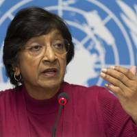 Horrors of war: U.N. High Commissioner for Human Rights Navi Pillay speaks during a news conference at the European headquarters of the United Nations in Geneva on Monday. Pillay says there is mounting evidence that Syrian government officials — including President Bashar Assad — are responsible for crimes against humanity and war crimes. | AP