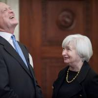 Chief in waiting: Federal Reserve Vice Chair Janet Yellen speaks with Charles Plosser, president of the Federal Reserve Bank of Philadelphia, in Washington on Monday during a gathering of the Fed's board of governors to commemorate the 100th anniversary of the signing of the Federal Reserve Act. | BLOOMBERG