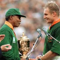 History in the making: South African President Nelson Mandela congratulates Springboks captain Francois Pienaar before handing him the Webb Ellis Cup after the 1995 Rugby World Cup final.   AP