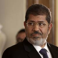 Morsi charged with espionage, plotting an Islamist takeover in 2011