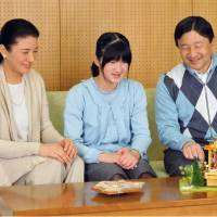 Milestone: Crown Princess Masako, who turned 50 Monday, is photographed ahead of her birthday with Crown Prince Naruhiko and their daughter, Princess Aiko, at the Togu Palace in Tokyo. | IMPERIAL HOUSEHOLD AGENCY/KYODO