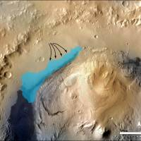 Watering hole: An illustration released Monday by NASA shows the possible size what was once an ancient lake inside Mars' Gale Crater. Analyzing sedimentary rock, NASA's Curiosity rover found evidence of the ancient lake . The possible extent was estimated by mapping stream deposits and recognizing that water flowed from the crater rim into the basin (arrows). The water would have pooled in the linear depression created between the crater rim and Mount Sharp. | AFP-JIJI