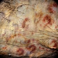 First art in Europe: The 'Panel of Hands' in El Castillo Cave in Spain has been dated to older than 40,800 years, making it the oldest cave art in Europe and possibly the work of Neanderthals. The bison overlay the hands and were therefore painted later. | AP