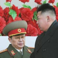 Booted: North Korean ruler Kim Jong Un (right) attends a military parade in Pyongyang with uncle Jang Song Thaek in February 2012. State media confirmed Monday that Jang, vice chairman of the country's top body and once seen as the power behind the throne, had been stripped of all official titles and membership in the ruling party for crimes including corruption, womanizing and factionalism. | KYODO