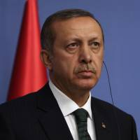 'Political ploting': Turkish Prime Minister Recep Tayyip Erdogan speaks during a news conference in Ankara on Wednesday. | AP