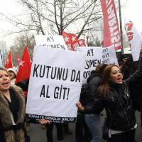 'Everywhere is bribery': Women hold a placard reading 'Government, resign' as people shout anti-government slogans during a protest against corruption in Ankara on Saturday. | AFP-JIJI