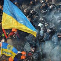 Feeling the heat: Riot policemen clash with protesters on Independence Square in Kiev on Wednesday. | AFP-JIJI