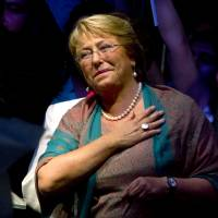 Returned to office: Chile's Michelle Bachelet smiles after hearing the results of the presidential election runoff in Santiago on Sunday. Bachelet rode a platform of boosting education and narrowing the gap between rich and poor to an overwhelming victory. | AFP-JIJI