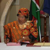 Brokers for healing: The chairwoman of the Southern African Development Community and president of Malawi, Joyce Banda (left), and the president of Uganda, Yoweri Museveni, sign as guarantors a landmark peace deal between M23 rebels and the Democratic Republic of Congo's government at State House in Nairobi on Thursday. | AFP-JIJI