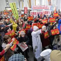 Up in arms: Protestors raise their voice over Okinawa Gov. Hirokazu Nakaima's approval Friday of offshore fill work for the base that is planned to replace U.S. Marine Corps Air Station Futenma as they occupy the prefectural government building Friday. | KYODO