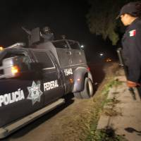 Toxic find: A Mexican Federal Police vehicle leaves the village of Hueypoxtla on Wednesday. Mexican troops and federal police kept a nighttime vigil guarding a rural field where thieves abandoned a shipment of highly radioactive cobalt-60 stolen Tuesday, while officials began planning the delicate task of safely recovering the material. | AP