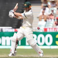 His turn: Australia's David Warner takse a swing during the second Ashes test against England in Adelaide, Australia, on Saturday. | AP
