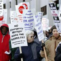 Out in force: Protesters rally outside federal court in Detroit during a trial Oct. 23 to determine the city's eligibility to restructure $18 billion in debt. | AP